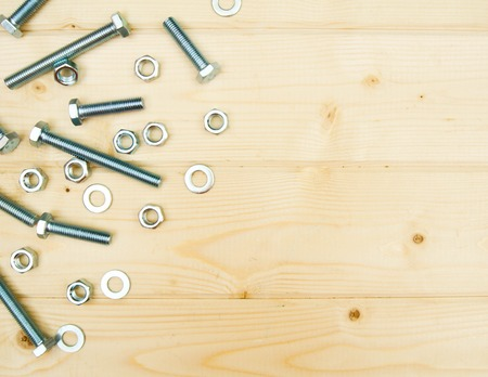 workroom: Fixing elements on wooden background. Stock Photo