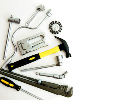 Metalwork. Hammer, stapler and others tools on white background. photo