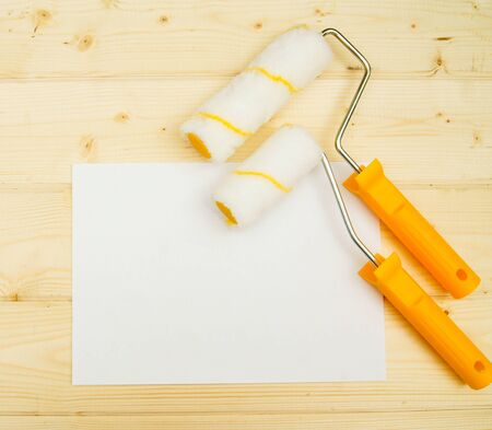 platen: Paper with platen for a paint on wooden background.