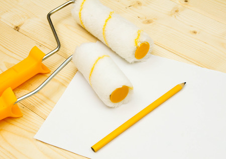 platen: Paper with pencil and platen for paint on wooden background.
