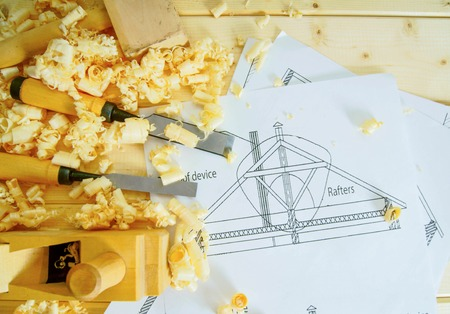 Joiners works. Drawings for building and working tools on wooden background. photo