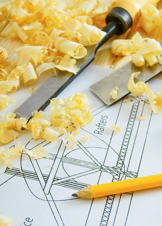 Planning of repair of the house. Woodworking. Drawings for building and working tools on wooden background.