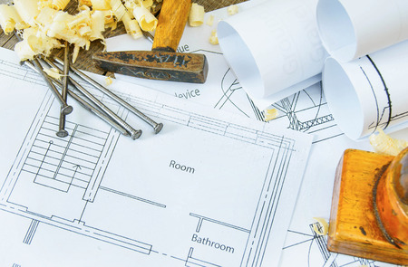 Planning of repair of the house. Joiners works. Drawings for building and working tools on old wooden background.