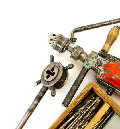 Old working tools. Vintage working tools ( drill and more) on white background. photo