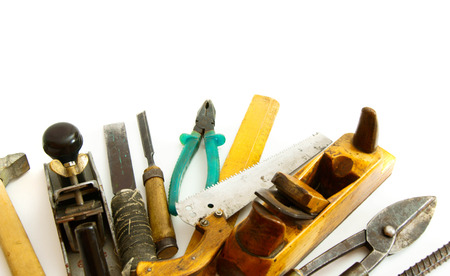 Old working tools. Vintage working tools ( drill, saw and others) on white background. photo