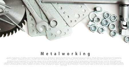 Metalwork. Spanner, ingot and others tools on white background. photo