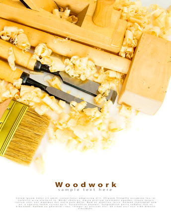 Joiners tools (plane, mallet, chisel) on a white background. photo