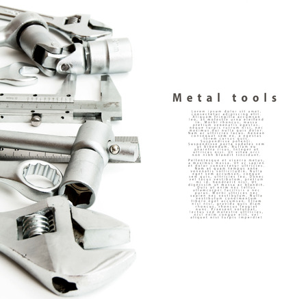 Metalwork. Ruler, caliper and others tools on white background. photo