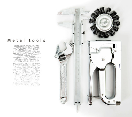 metalwork: Metalwork. Wrench, caliper and others tools on white background.