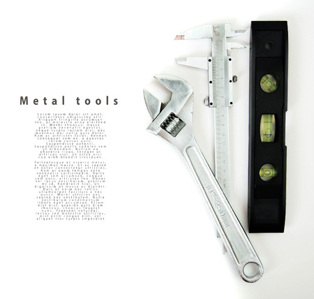 Metalwork. Wrench, caliper and others tools on white background. photo