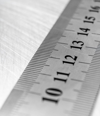 calibrate: Ruler on the scratched metal background.