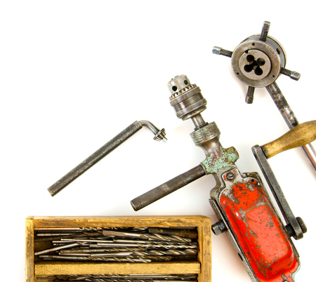 Vintage working tools ( drill and more) on white background. photo