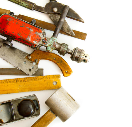 Vintage working tools (drill, ruler and others) on white background. photo