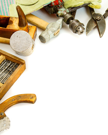 Vintage working tools ( hammer, drills and others) on white background. photo