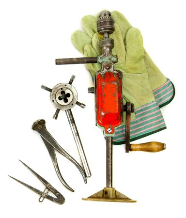 Vintage working tools ( drill, glove and others) on white background. photo