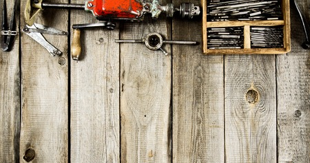 old tools: Many working tools on a wooden background.