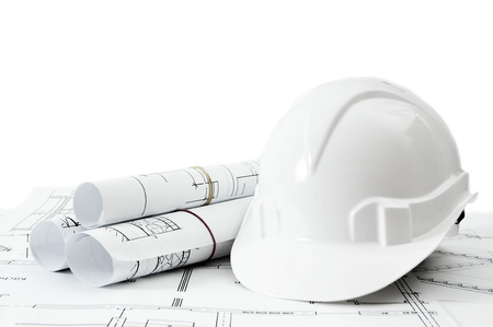 construction project: Construction house. Repair work. Drawings for building and helmet on white a background. Stock Photo