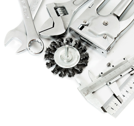 metalwork: Metal working tools. Metalwork. Ruler, caliper and others tools on white background.