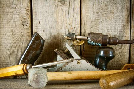Old working tools. Many old tools (plane, mallet and others) on a wooden shelf. photo