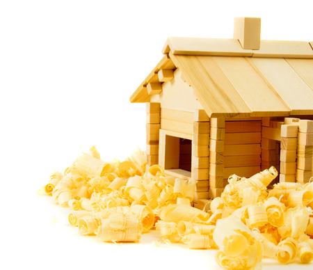roof house: Woodworking. House construction. Joiners works. The wooden house and shaving on white background.