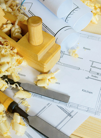 Planning of repair of the house. Joiners works. Drawings for building and working tools on wooden background. photo