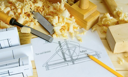 Planning of repair of the house. Woodworking. Drawings for building and working tools on wooden background. photo