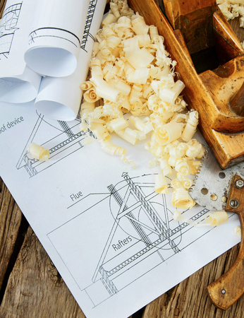 Repair work. Joiners works. Drawings for building and working tools on wooden background. photo