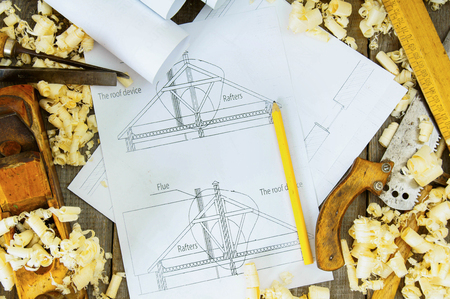 Planning of repair of the house. Joiners works. Drawings for building and working tools on old wooden background. photo