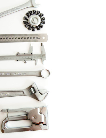 Metal working tools. Metalwork. Ruler, caliper and others tools on white background. photo