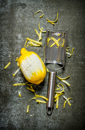 cheese grater: Clean the lemon with a cheese grater. Stock Photo