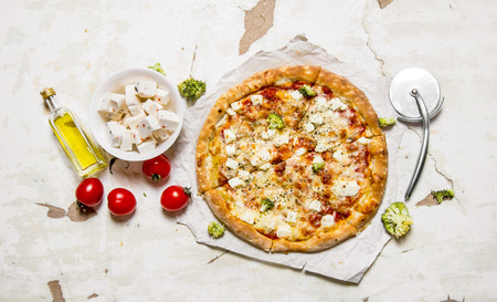 rustic food: Cheese pizza with tomatoes and fresh cheese On rustic background. Top view