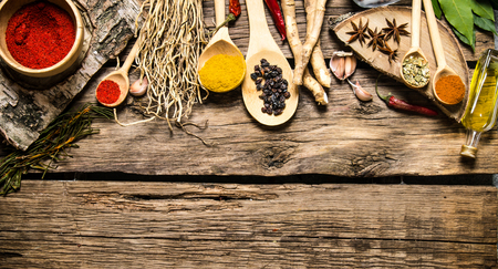 aromatic: Aromatic spices and herbs on a rustic background.