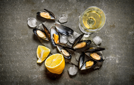Clams with wine and lemon. On the stone table. Top view
