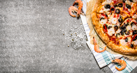 tomato paste: Pizza with shrimp, tomato paste and olive oil. On the stone table.