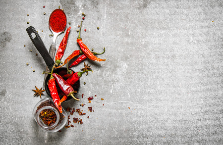 Dried peppers in a jar. On a stone background. Reklamní fotografie
