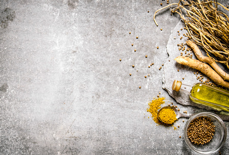 Spices, herbs and olive oil on a stone stand. Stock Photo