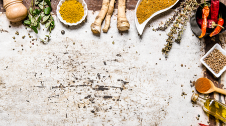 Different spices, herbs and roots view from the top. On rustic background. Free space for text . Top view Stock Photo