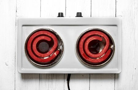 woo: The concept of running a heated electric cooker . Top view