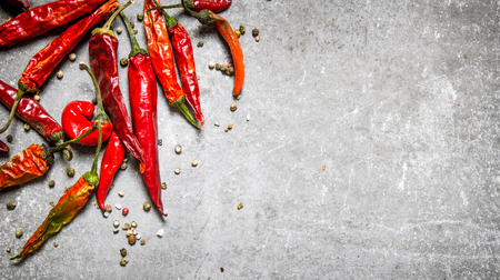 Red chili pepper dried. On a stone background. Free space for text . Top view Archivio Fotografico