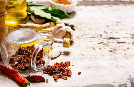 spice: Spices and herbs - pepper, Bay leaf, garlic, coriander powder, and others. On rustic background. Free space for text . Stock Photo