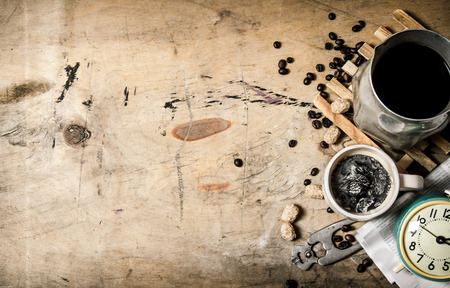 old time: Coffee style. Morning coffee with fresh newspaper. On wooden background.