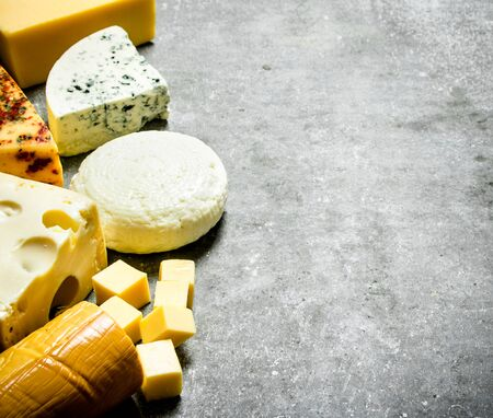different types of cheese: Different types of cheese. On the stone table.