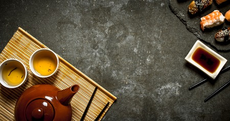 free backgrounds: Sushi with soy sauce and fragrant tea. On the stone table