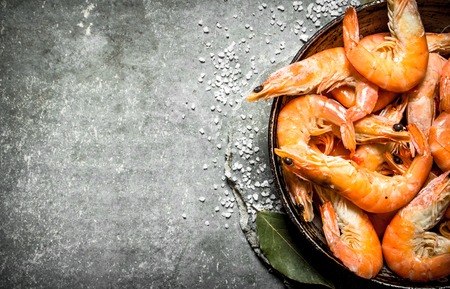 Shrimp with salt and Bay leaf. On the stone table. Stock Photo
