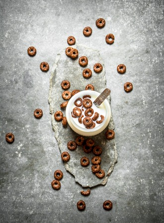 chocolate cereal: Chocolate cereal with milk. On the stone table. Stock Photo