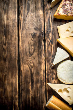 different types of cheese: Different types of cheese . On a wooden table. Stock Photo
