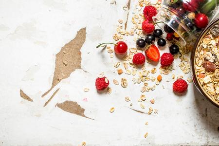 rustic food: Healthy food. Muesli with wild berries. On rustic background.
