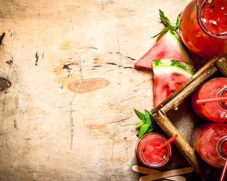 pulp: Watermelon juice with pulp. On wooden background.