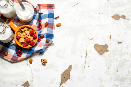 rustic food: Healthy food. Muesli with forest wild berries. On rustic background. Stock Photo