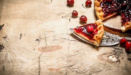 golden shovel: Cut a piece of cherry pie. On a wooden table